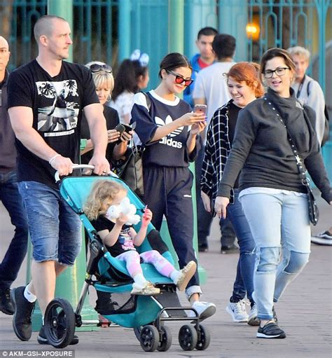 Selena Gomez hits Disneyland with her family   Daily Mail