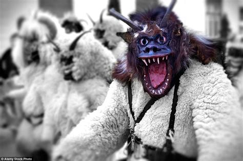 Hungarian festival where revellers don grotesque masks to