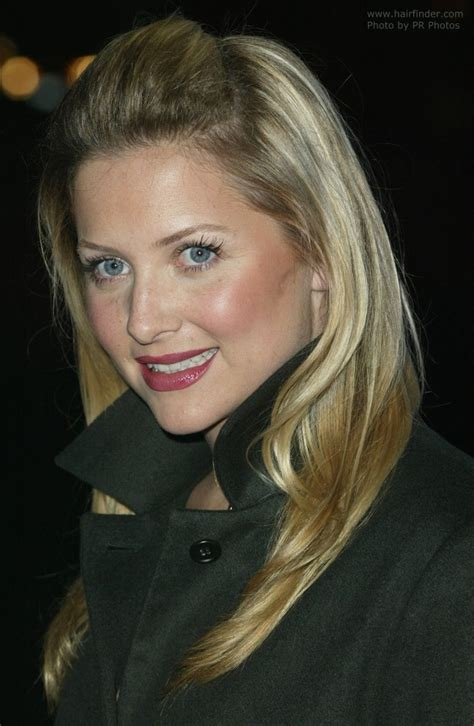 Jessica Capshaw's hair brought back and fastened on the